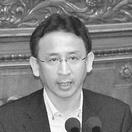 (写真)反対討論する塩川鉄也議員=5月20日、衆院本会議