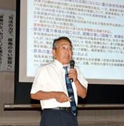 講演する、木原壮林・京都工芸繊維大名誉教授